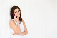 Beautiful woman talking on cellphone Stock Photography