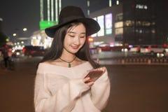 Beautiful women playing mobile phone Stock Image