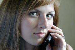 Beautiful woman talking by the mobile Stock Image