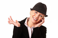 Beautiful woman is talking on mobile phone royalty free stock photography
