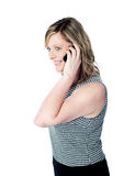 Beautiful woman talking on mobile phone Stock Image