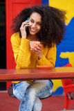 Beautiful woman talking on mobile phone in cafe Stock Images
