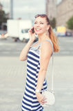 Beautiful woman talking on mobile phone in the city Royalty Free Stock Photos