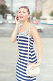 Beautiful woman talking on mobile phone in the city Stock Image