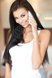 Beautiful woman talking on a mobile phone Royalty Free Stock Photography