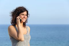 Beautiful woman talking on the mobile phone Stock Photo