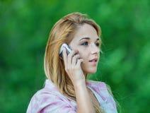 Beautiful woman talking mobile phone Stock Photo