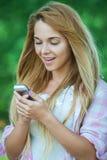 Beautiful woman talking mobile phone Royalty Free Stock Image