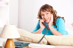 Beautiful woman talking on the phone Stock Photo