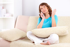 Beautiful woman talking on the phone Stock Images