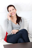 Beautiful woman talking on the phone. Royalty Free Stock Image