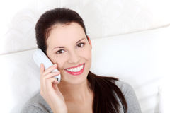 Beautiful woman talking on the phone. Stock Photos