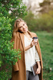 Beautiful woman talking on the phone and drinking coffee Royalty Free Stock Photos