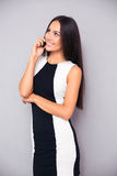 Beautiful woman talking on the phone and looking up Royalty Free Stock Photo