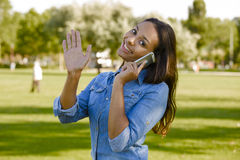 Beautiful woman talking at phone Stock Photos