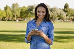 Beautiful woman talking at phone Stock Image