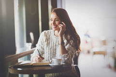 Beautiful woman talking on phone in restaurant Royalty Free Stock Photo
