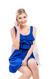 Beautiful woman talking by phone Royalty Free Stock Photo