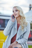 Beautiful woman  talking on the phone on the street Royalty Free Stock Image