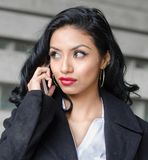 Beautiful woman talking on phone royalty free stock photo