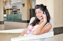Beautiful woman talking on phone Stock Photos