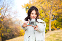 Beautiful woman talking a self photographing Royalty Free Stock Image