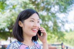 Beautiful woman talking by smart phone Stock Image