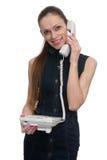 Beautiful woman talking on telephone. Isolated Stock Image