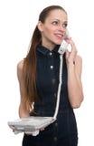 Beautiful woman talking on telephone. Isolated Stock Photos