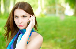 Beautiful woman talks by mobile Stock Photo