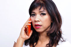 Beautiful woman talks on mobile phone Stock Images