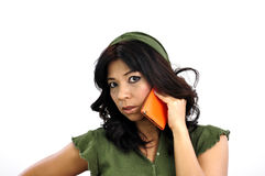 Beautiful woman talks on mobile phone Royalty Free Stock Photography