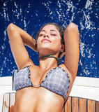Beautiful woman tanning on sailboat Royalty Free Stock Images