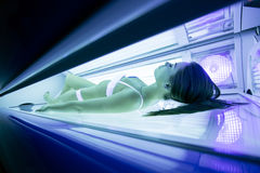 Beautiful woman tanning in solarium Stock Images
