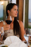Beautiful woman tasting red wine at restaurant Royalty Free Stock Images