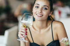 Beautiful woman tasting wine Stock Images