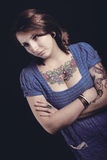 Beautiful woman with tattoo in black background Stock Images
