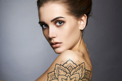 Beautiful woman with tattoo and make-up Stock Photo