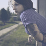 Beautiful woman with tattoo in vintage style Royalty Free Stock Photography