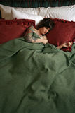 Beautiful woman with tattoos sleeping Stock Image