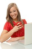 Beautiful woman with tea and laptop Stock Photo