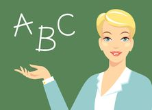 Beautiful woman teacher near blackboard Stock Image