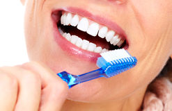 Beautiful woman teeth with a toothbrush. Royalty Free Stock Image