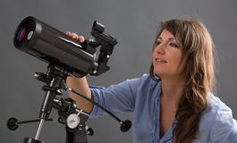 Beautiful woman with telescope Royalty Free Stock Photography