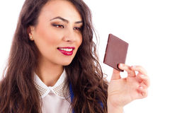 Beautiful woman tempted by chocolate Royalty Free Stock Photos