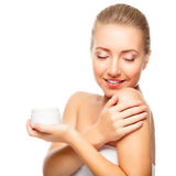 Beautiful woman tender jar of moisturizer Stock Image