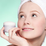 Beautiful woman tender jar of moisturizer cream Royalty Free Stock Photo