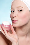 Beautiful woman tender jar of moisturizer cream Royalty Free Stock Photography