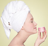 Beautiful woman tender jar of moisturizer cream Stock Photos
