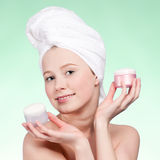 Beautiful woman tender jar of moisturizer cream. Royalty Free Stock Photos